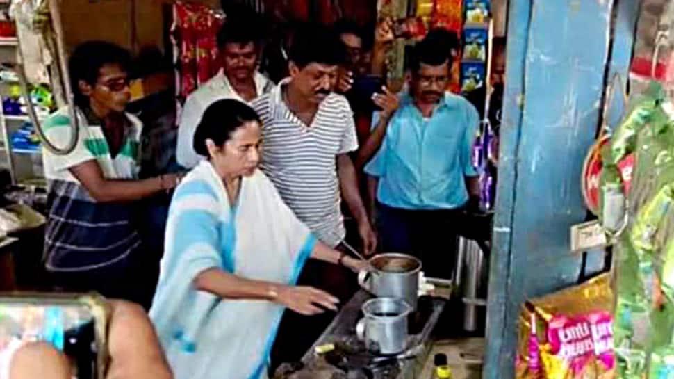 Bengal CM Mamata Banerjee brews tea at local stall during village visit