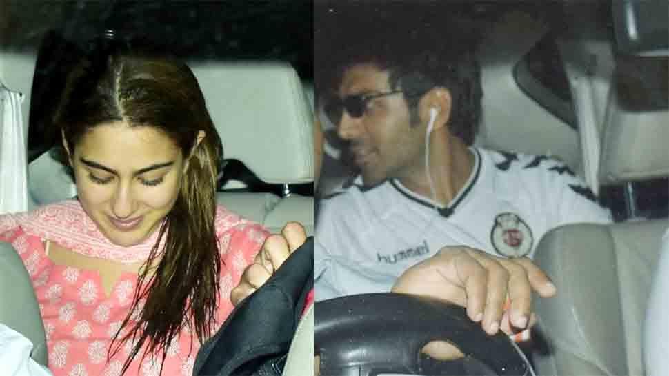 Sara Ali Khan blushes in pink as she receives Kartik Aaryan at airport — See pics