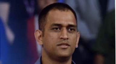 MS Dhoni spotted in brand new look at Jaipur airport--Watch