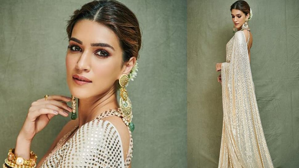 Kriti Sanon looks beautiful in a sequin saree for Ganesh Chaturthi celebrations—Pics