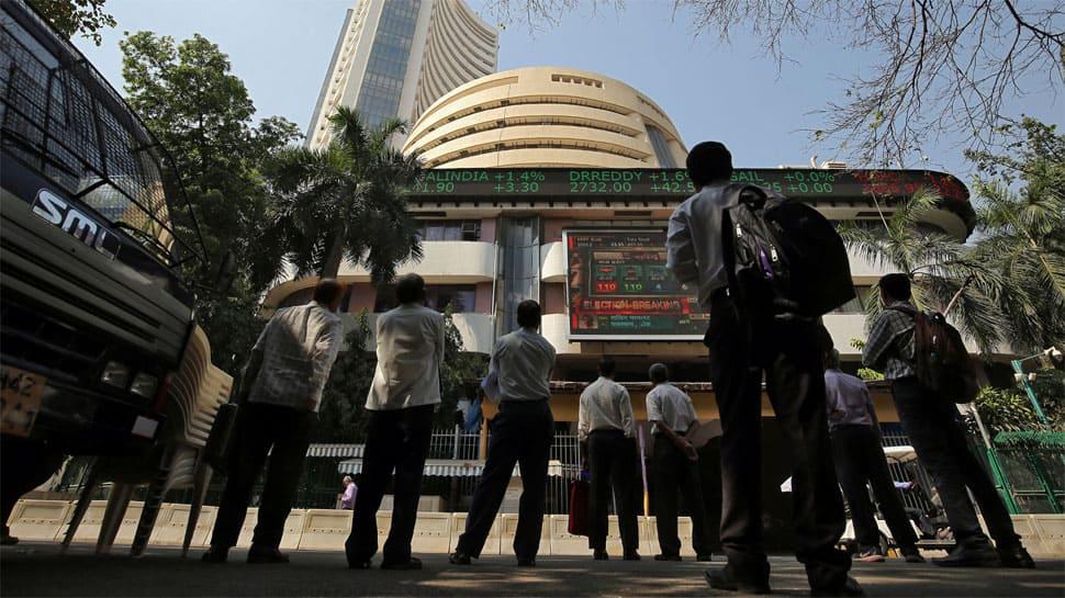 Markets pare losses, Sensex jumps 161 points, Nifty ends above 10,800