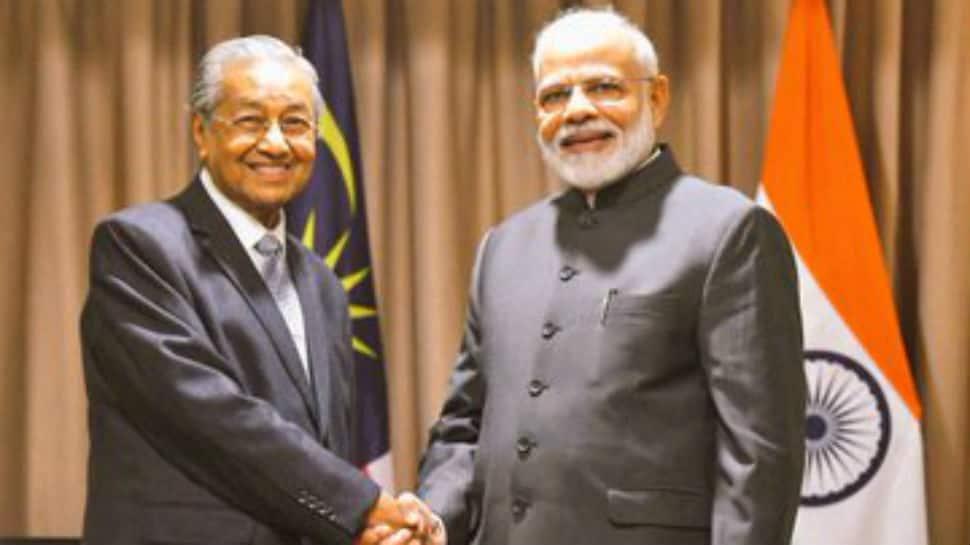 PM Modi meets Malaysian counterpart Mahathir Bin Mohamad in Russia, raises issue of Zakir Naik's extradition