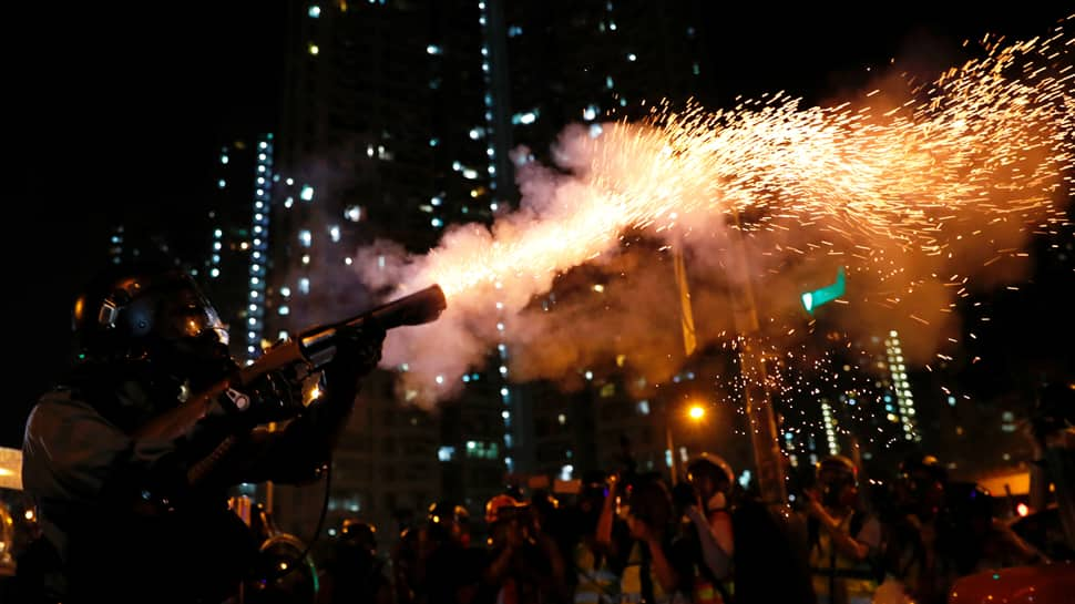 Hong Kong police fire tear gas as clashes erupt after protesters seek help from Donald Trump