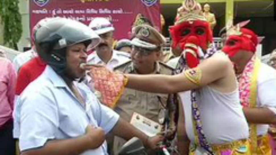 In pics: Lord Ganpati offers laddoos to those riding bike wearing helmet in Rajkot
