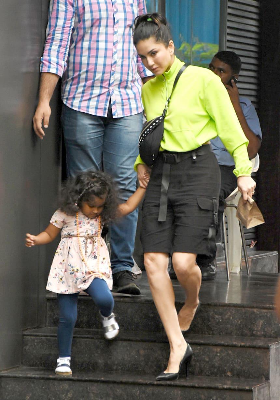 Sunny Leone holds Nisha's hand