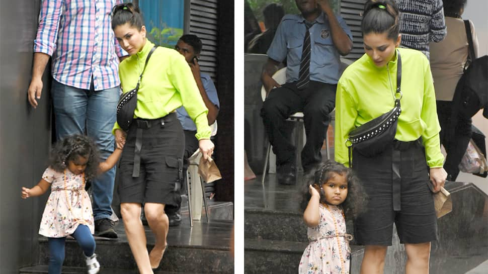 Sunny Leone pulls off a stunning neon outfit on her day out with kids - Photos