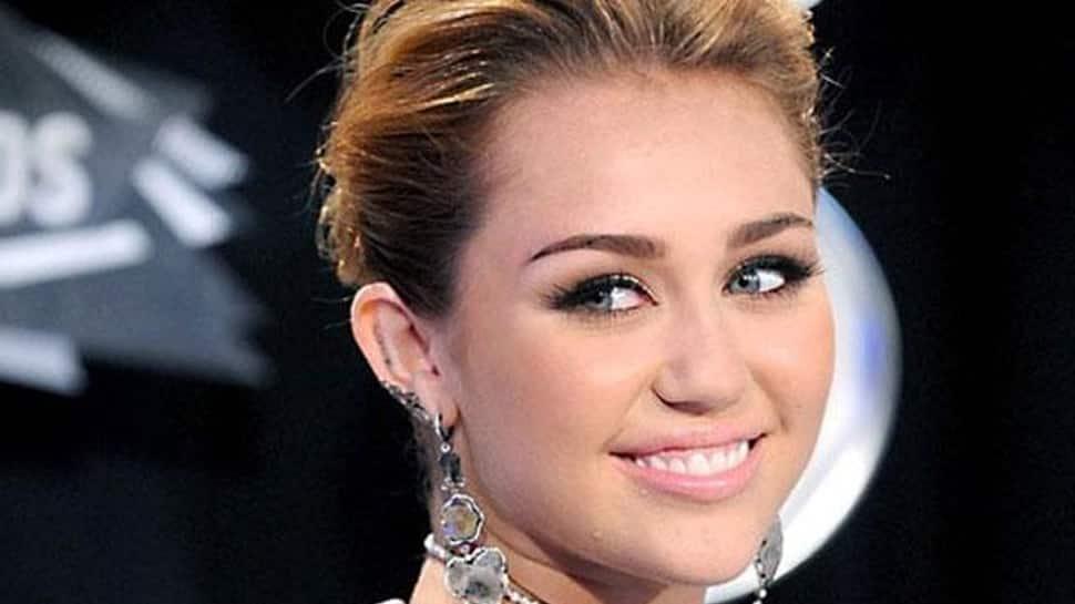 Miley Cyrus' stalker arrested at her concert