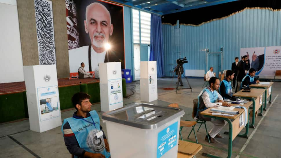 Afghanistan voters defy attacks, delays to vote for president