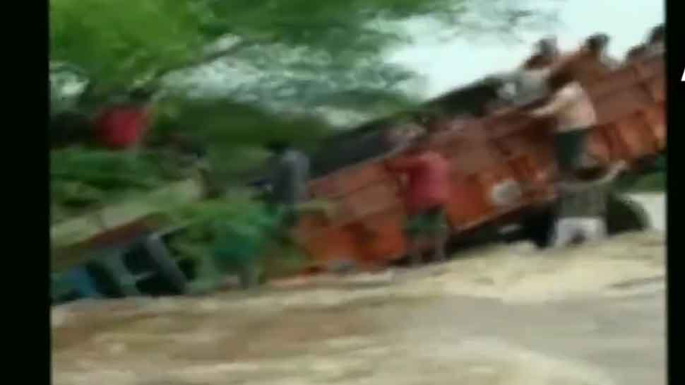 Narrow escape for students as truck carrying them veers off flooded road in Rajasthan - WATCH
