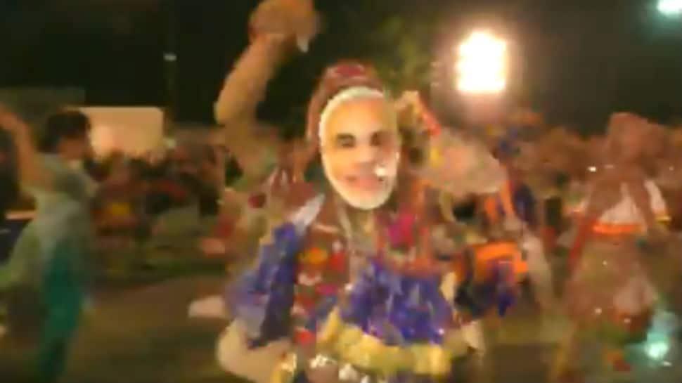 Watch: People wear PM Modi masks while performing garba in Surat