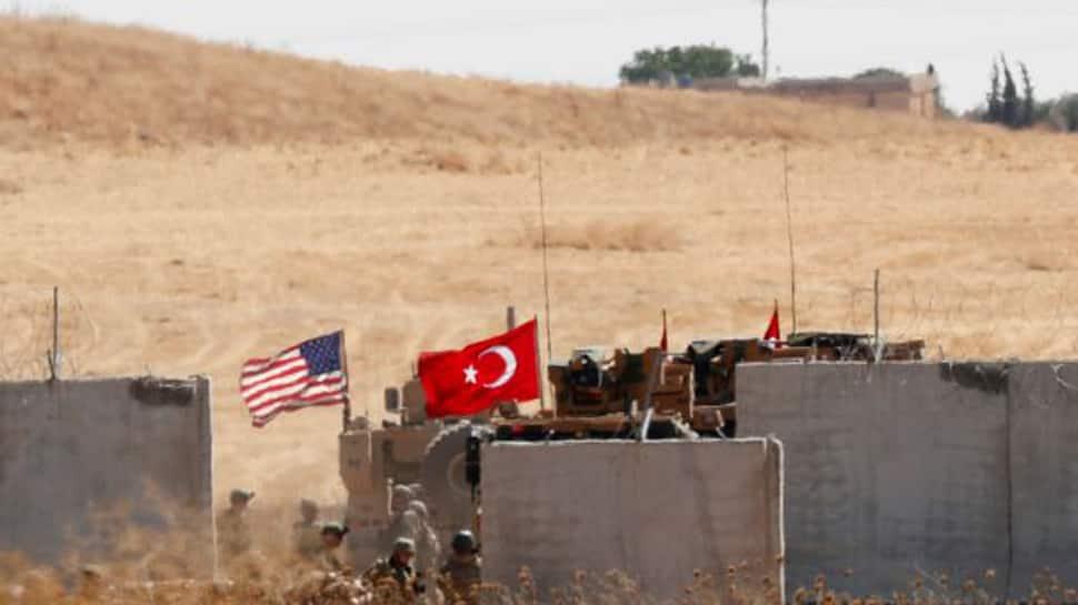 Turkey says it's ready for Syria push, Kurds signal Damascus talks