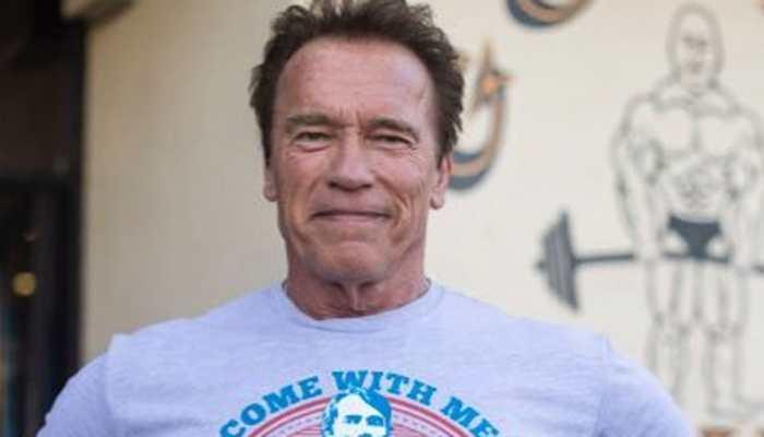 Arnold Schwarzenegger admires Tim Miller