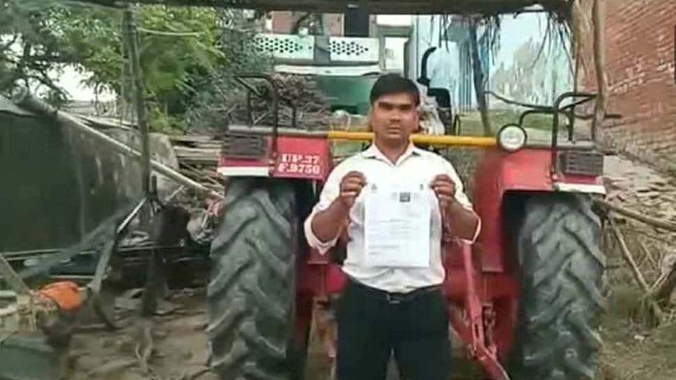 Tractor driver fined Rs 3,000 for driving without helmet, licence in UP's Hapur