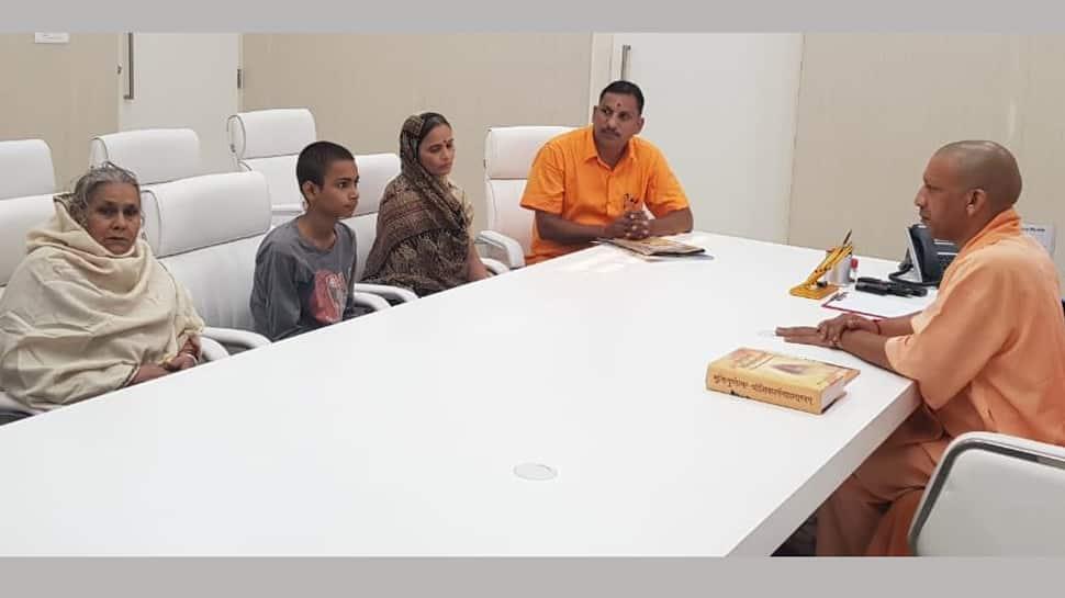 Uttar Pradesh Chief Minister Yogi Adityanath meets Kamlesh Tiwari's family
