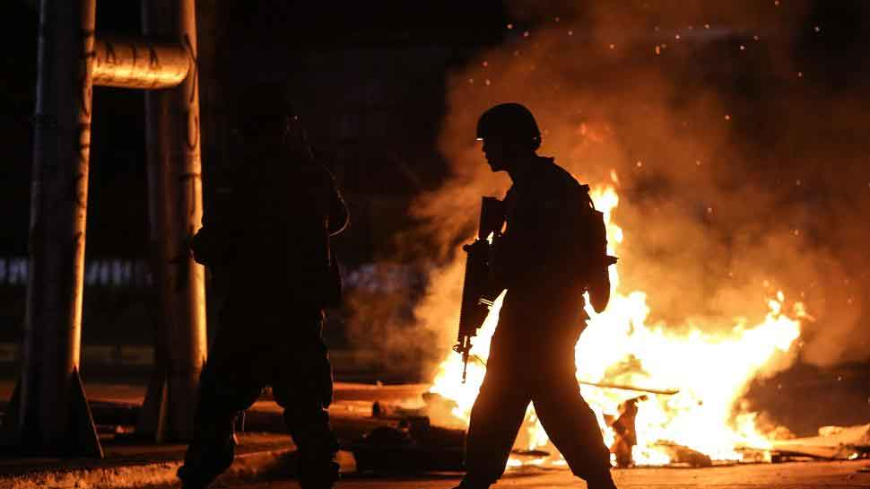 Death toll rises to 11 after weekend of violent protests in Chile