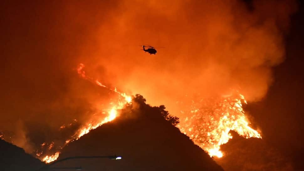 Multimillion-dollar homes burn in Los Angeles wildfire, celebrities flee