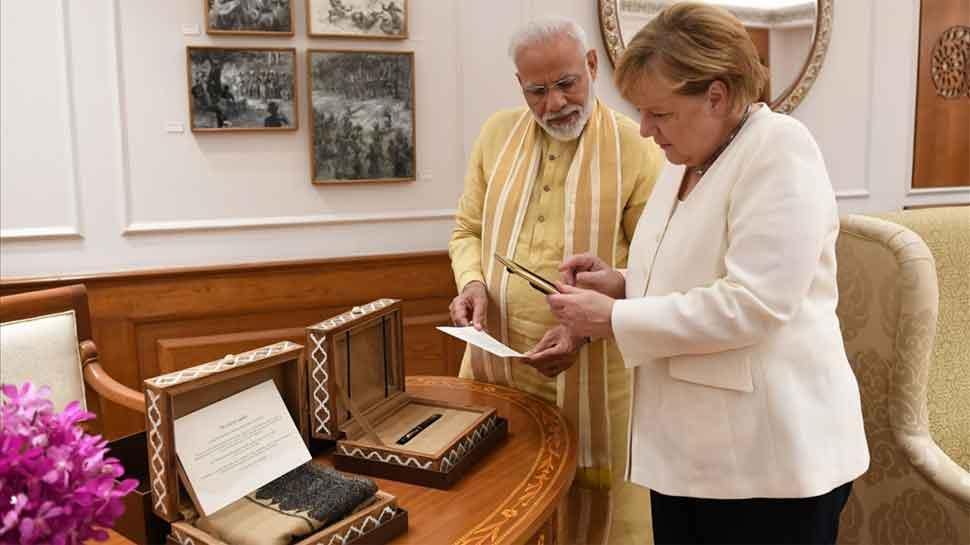 PM Narendra Modi gifts Ladakhi woollen khadi stole, Ratnam pen to Angela Merkel