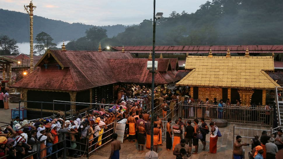 Sabarimala Temple opens amid tight security arrangements, 10 women devotees stopped in Pamba