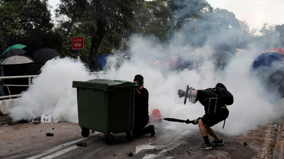 Handful of Hong Kong protesters surrender as university siege staggers on