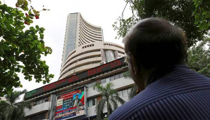 Sensex sheds 215 points, Nifty holds 11,900; Eicher Motors, Tata Steel major gainers