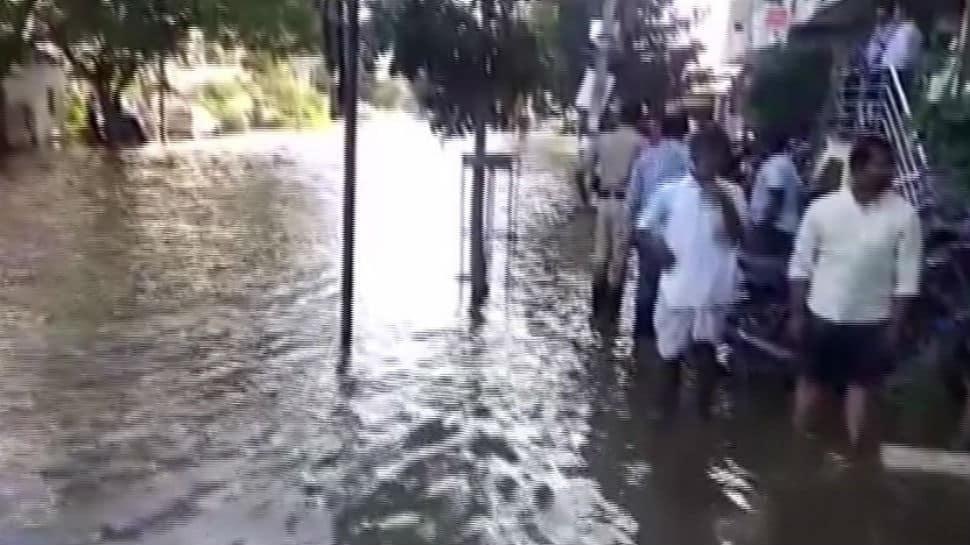 Lake breach hits Bengaluru, several families affected, cars swept away