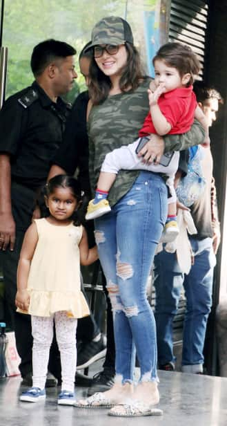 Sunny Leone poses with kids