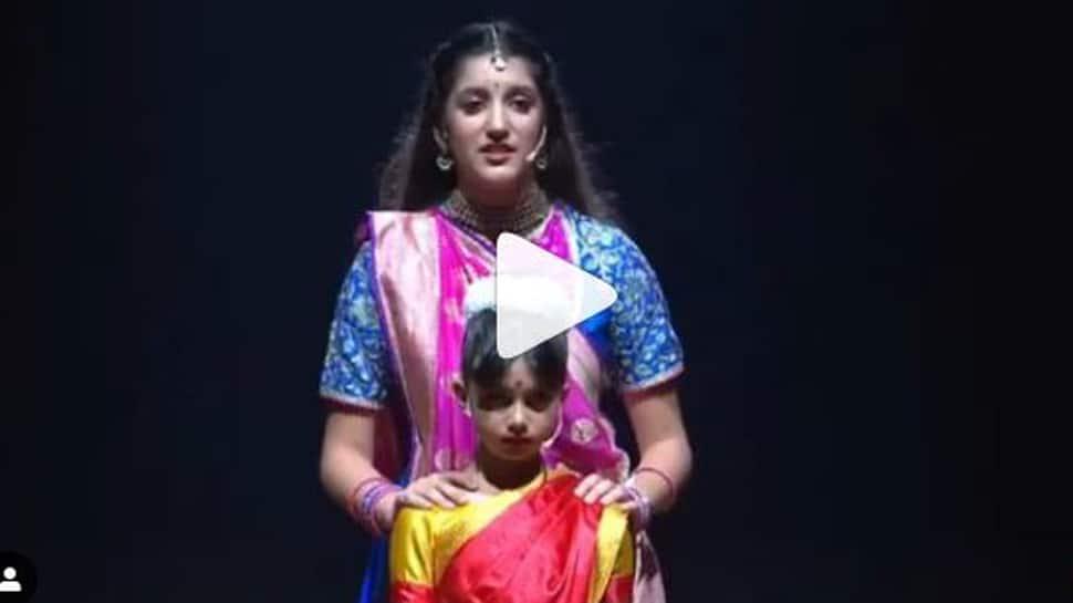 Aishwarya Rai- Abhishek Bachchan turn photographers as Aaradhya performs on stage