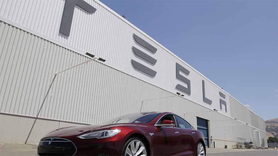 Tesla extends profit run, promises record production, driving stock up 13%