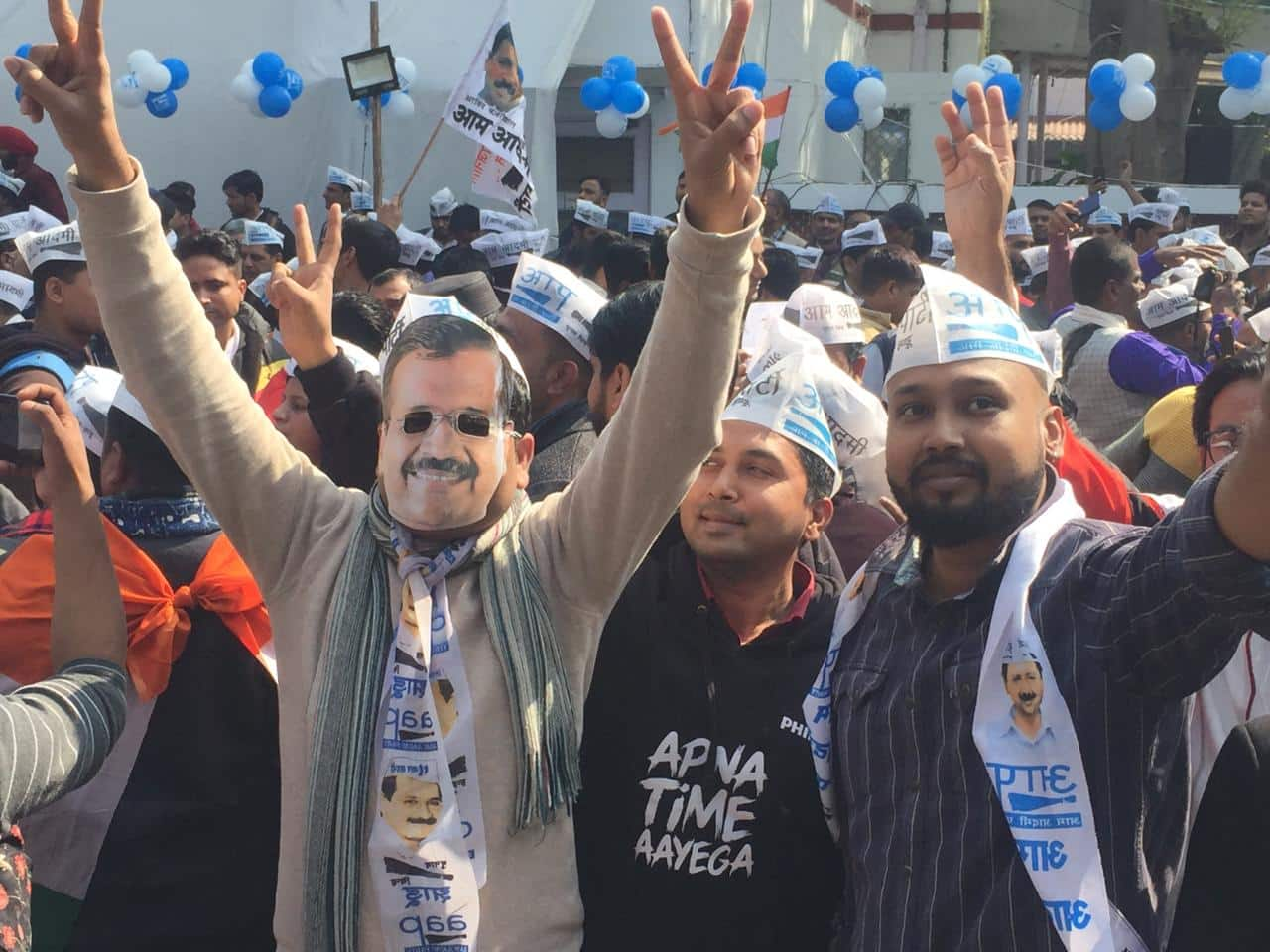 Supporters celebrating with Kejriwal's mask on