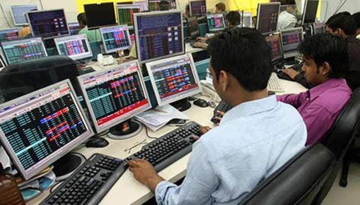 Sensex gains 300 points, Nifty touches 12,200; IndusInd Bank loses 3%
