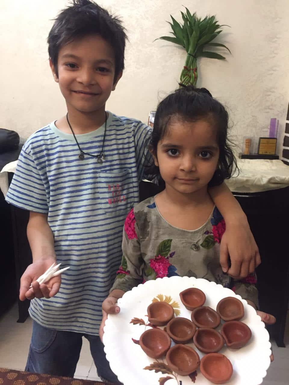 Kids with diyas