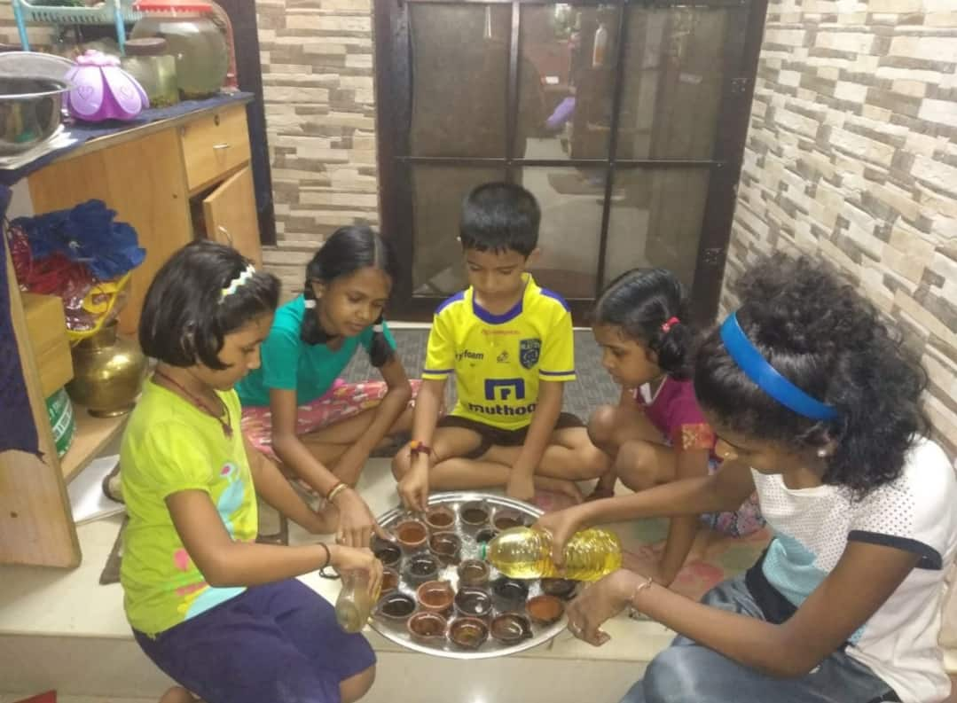 Kids preparing their diyas