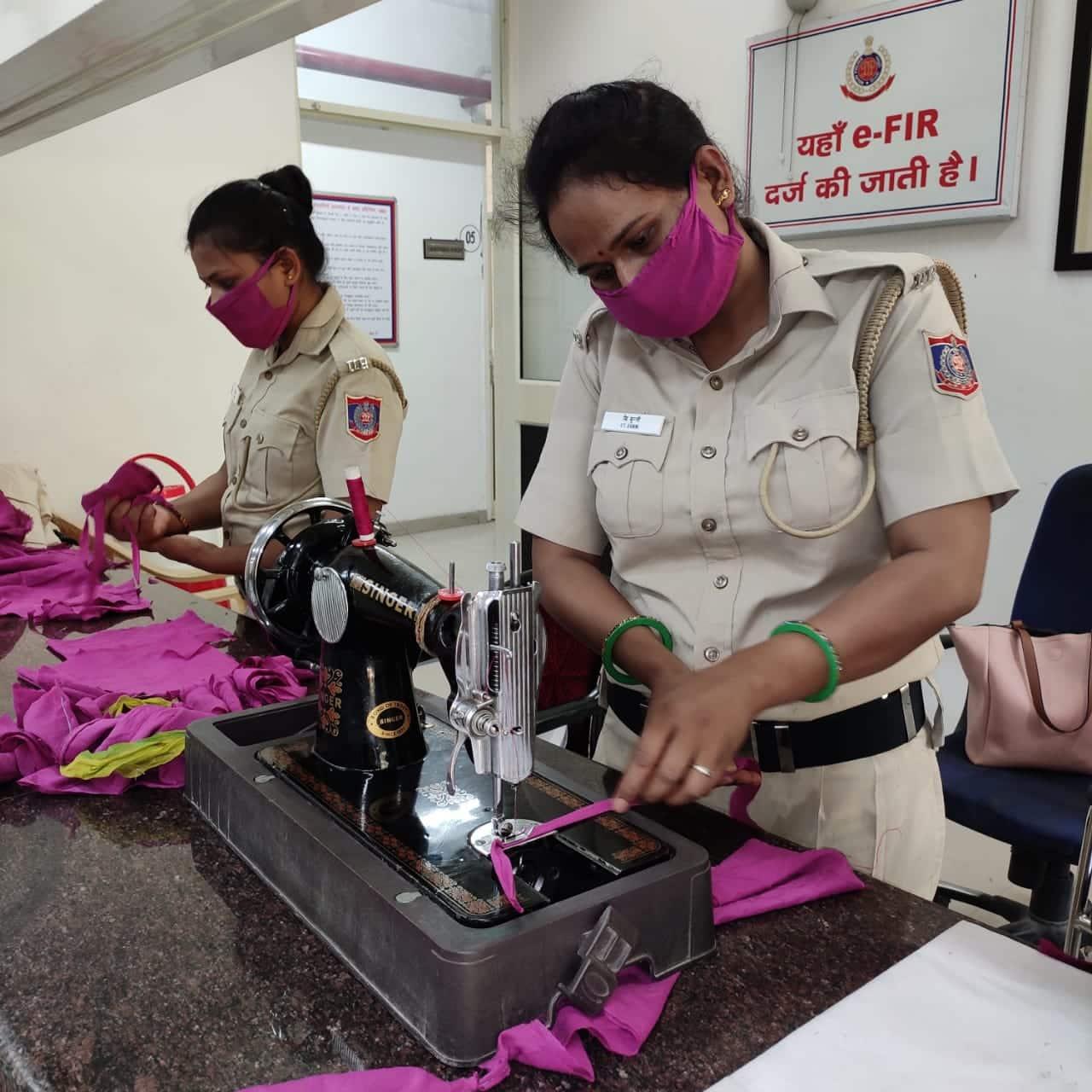 Delhi police women personnel making face masks