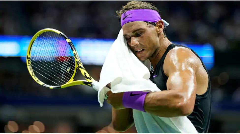 Rafael Nadal dons new look as he returns to court for first time since March