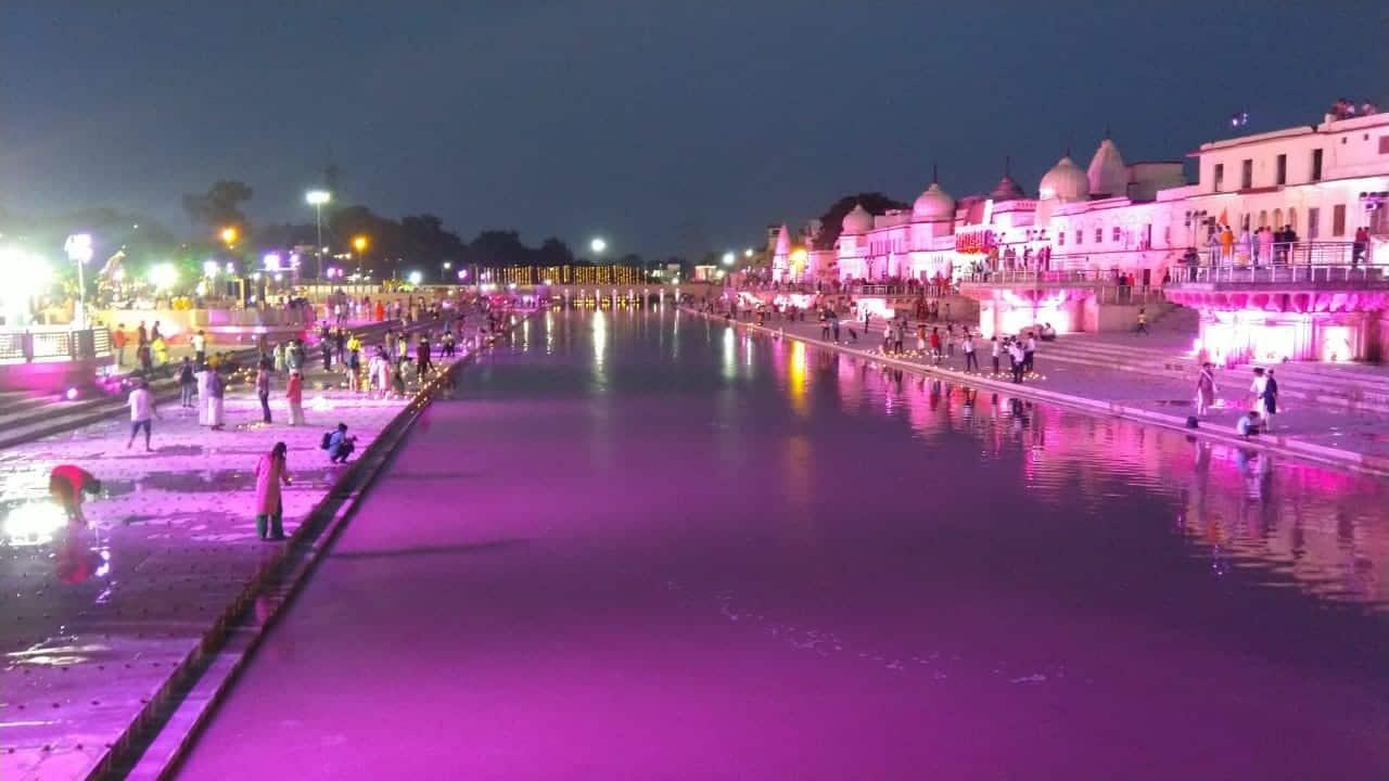 Devotees seen lighting diyas at the banks of Saryu river