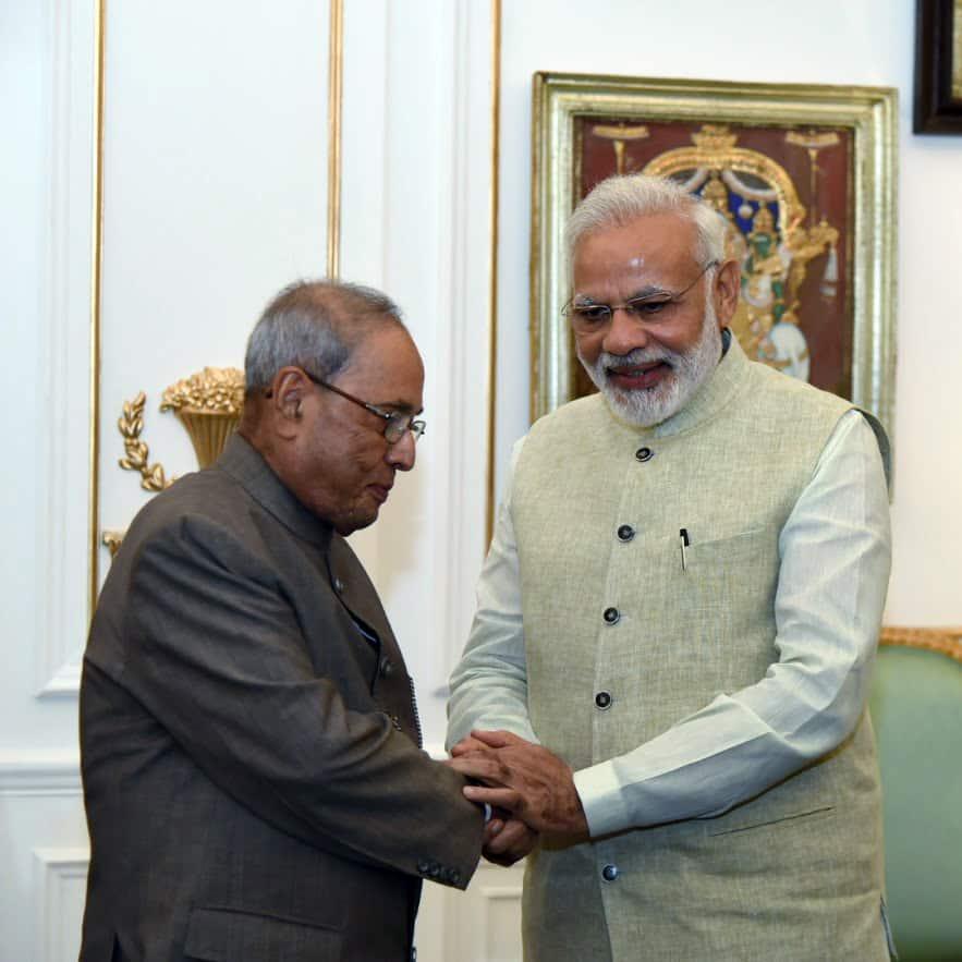 Prime Minister Narendra Modi with former President Pranab Mukherjee (1)