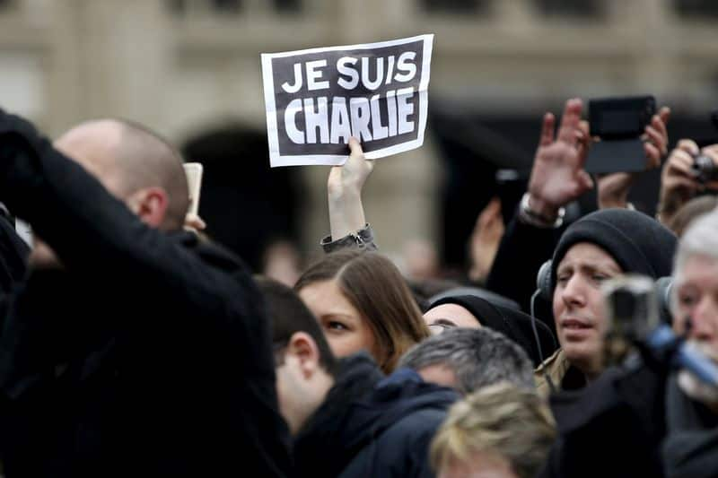 French magazine Charlie Hebdo uncowed after attacks - but now with bodyguards