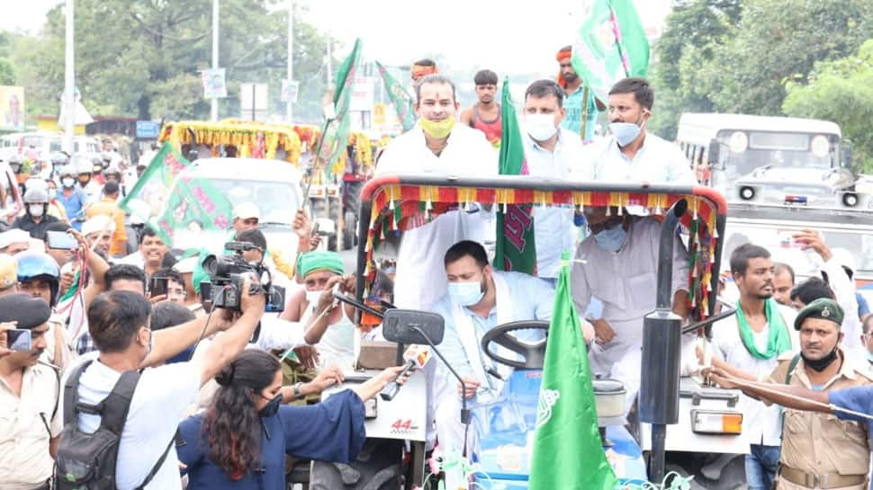 RJD leader Tejashwi Yadav drives tractor, brother Tej Pratap Yadav sits atop it during protest over Farm Bills: Watch