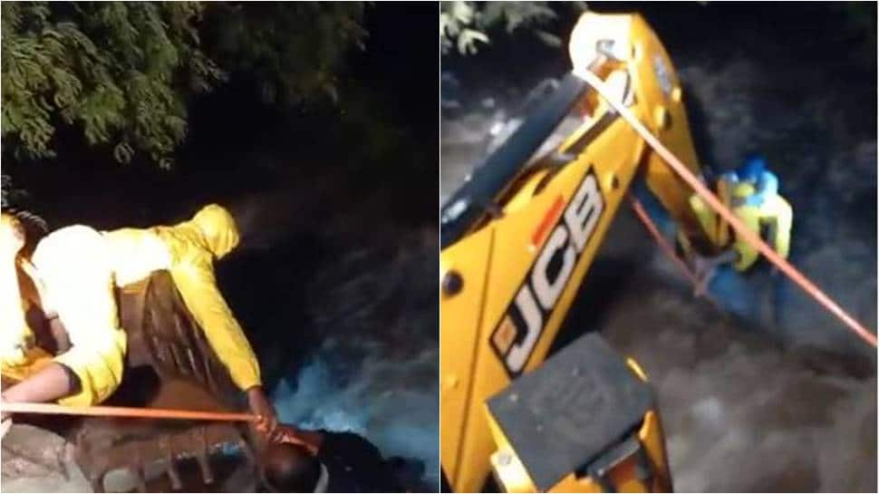 Pune man washed away in rain water rescued with help of JCB: WATCH
