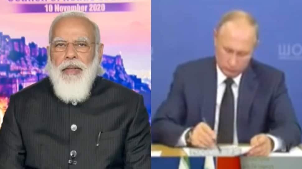 Russian President Vladimir Putin takes note as PM Narendra Modi speaks at SCO meet in front of Chinese President Xi Jinping