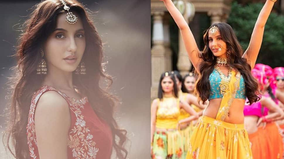 Dear Nora Fatehi, stop making mortals go crazy with your pics in a designer saree!
