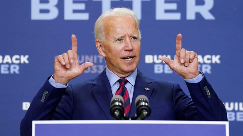 Joe Biden wins majority of Electoral College votes to confirm his win as US President