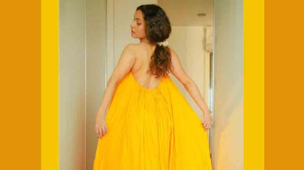 माधुरी दीक्षित के धक धक ट्रैक में डांस करने के बाद, अंकिता लोखंडे ने पीले रंग की बैकलेस ड्रेस में फ्लॉलेस स्किन को फ्लॉन्ट किया