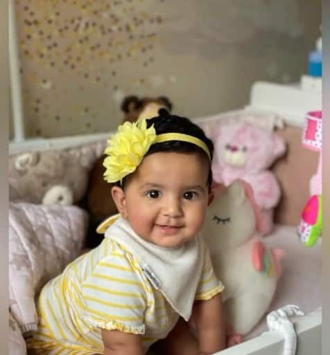 Baby Samisha looks like a sunshine in a yellow outfit