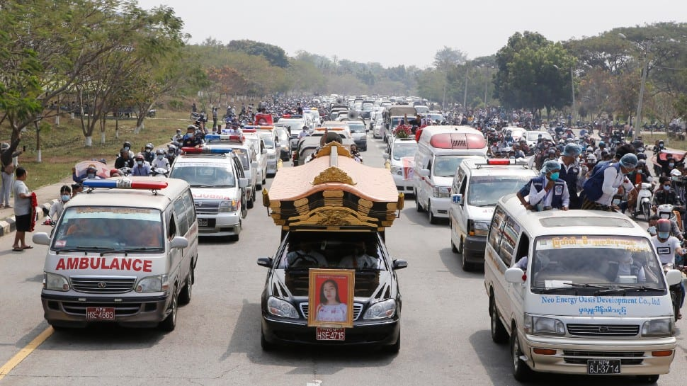 A Hearst containing casket of Mya Thwet Thwet Khine travels to the cemetery in Myanmar