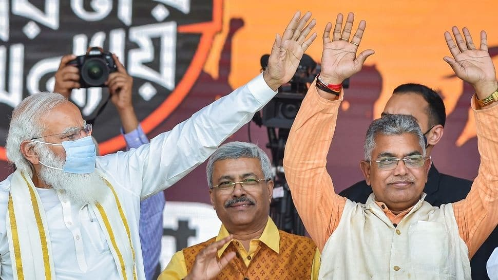 Prime Minister Narendra Modi sharing stage with state BJP President Dilip Ghosh