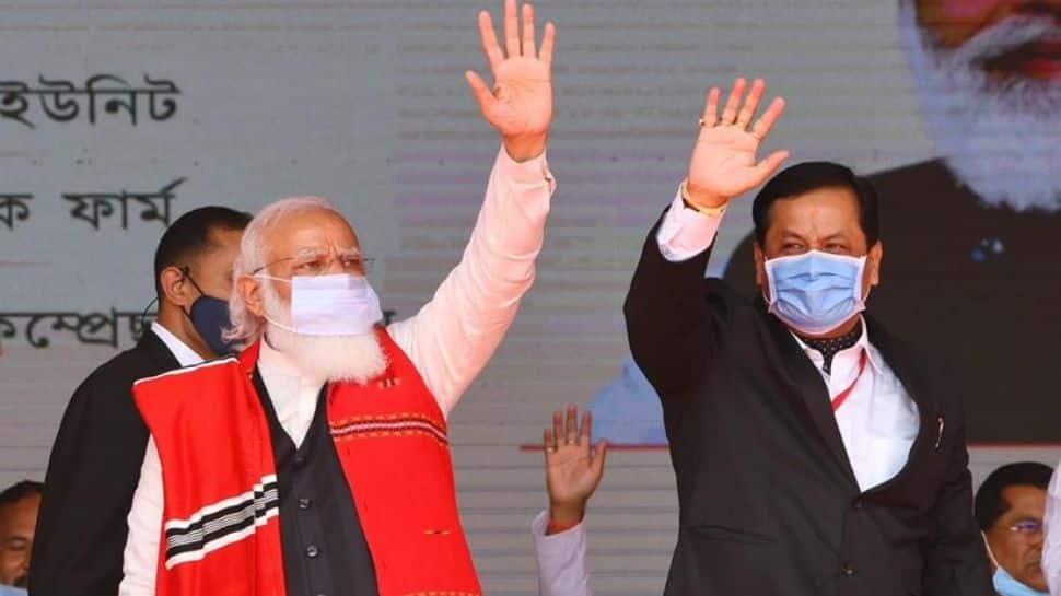 Prime Minister Narendra Modi along with Assam Chief Minister Sarbananda Sonowal
