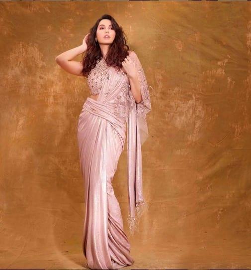 Nora looks splendid in a blush saree