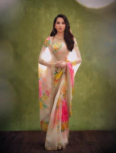 Nora Fatehi looks dreamy in a floral saree