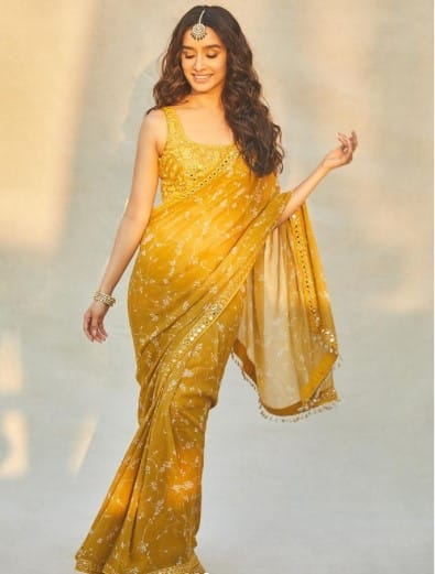 Shraddha Kapoor looks ethereal in a mustard saree